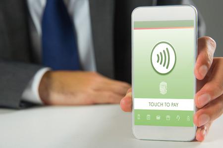 Businessman using smartphone against web