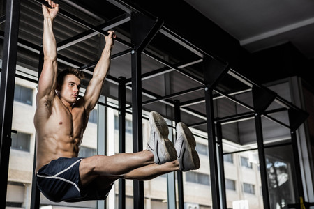 Photo for Shirtless man doing pull up at the crossfit gym - Royalty Free Image