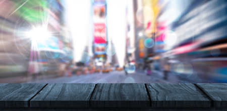 Wooden desk against blurry new york street