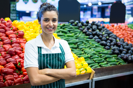 Photo for Portrait of female staff standing with arm crossed in organic section of supermarket - Royalty Free Image