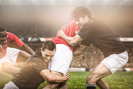 3D Rugby fans in arena against rugby players tackling during game
