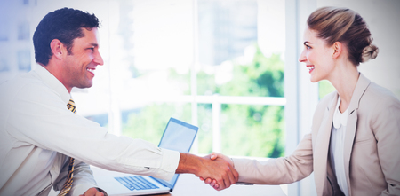 Photo pour Blond businesswoman having an interview in office and shaking hands with interviewer - image libre de droit