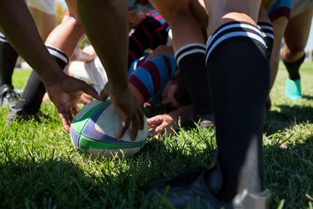 Photo pour Close up of rugby team at field on sunny day - image libre de droit