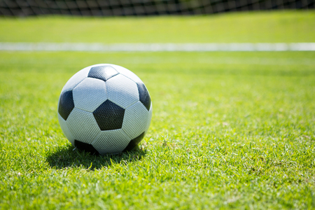Close up of soccer ball on playing field