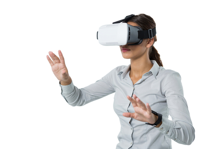 Photo pour Female executive using virtual reality headset against white background - image libre de droit