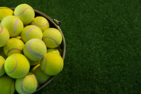 Photo for High angle view of fluorescent tennis balls in bucket on field - Royalty Free Image