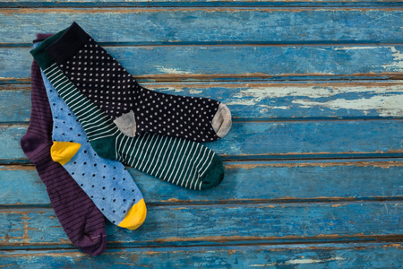 Photo pour High angle view of socks on wooden table - image libre de droit