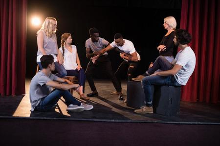 Foto de Actors practicing play on stage in theatre - Imagen libre de derechos