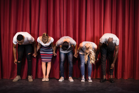Photo for Actors bowing on the stage in theatre - Royalty Free Image
