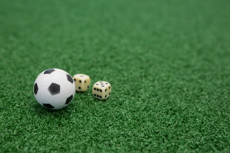 Foto de Close-up of football and dices on artificial grass - Imagen libre de derechos