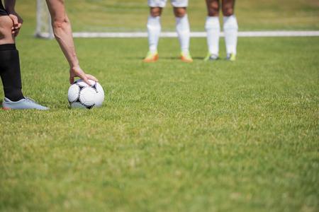 Foto de Soccer player is ready to kick ball from penalty spot in the ground - Imagen libre de derechos