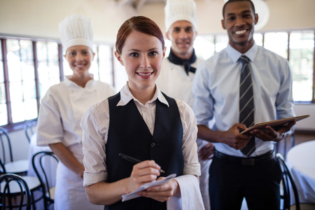 Photo for Group of hotel staffs standing together in hotel - Royalty Free Image