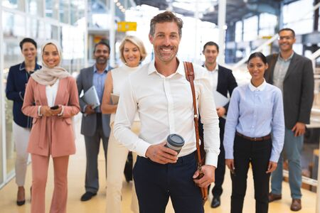 Photo pour Front view of Happy diverse  business people looking at camera while standing in a modern office. International diverse corporate business partnership concept - image libre de droit