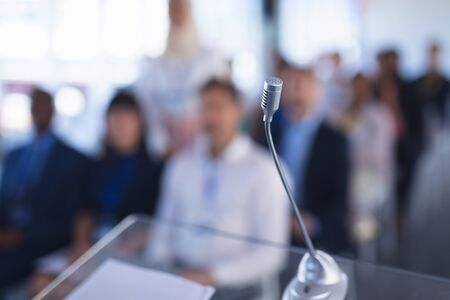 Photo for Close-up of microphone in business seminar at conference meeting. International diverse corporate business partnership concept - Royalty Free Image
