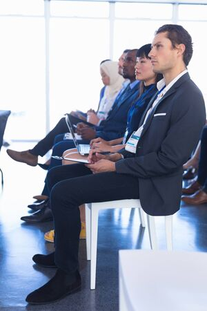 Photo pour Side view of diverse Business people attending business seminar in conference meeting. International diverse corporate business partnership concept - image libre de droit