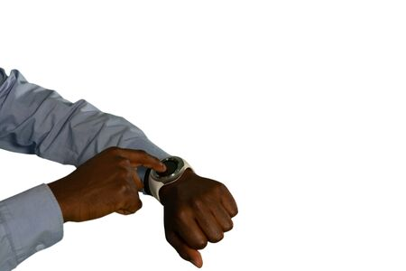 Photo for Mid section close up of a young African American man wearing a blue shirt using a smartwatch - Royalty Free Image