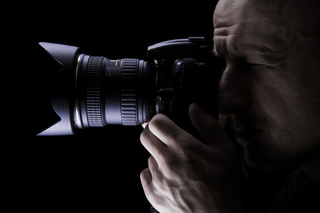 Photo for Young professional photographer taking pictures with digital camera - Royalty Free Image