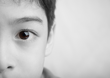 Close up spot color eyes of boy black and white