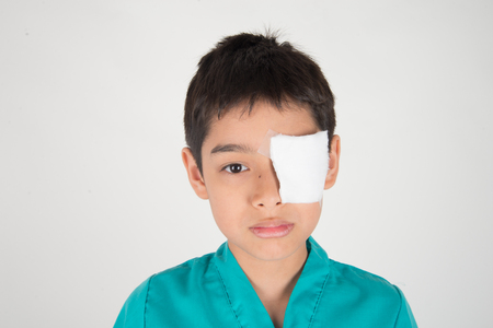 Photo for Little boy has eyes pain use bandage to cover - Royalty Free Image
