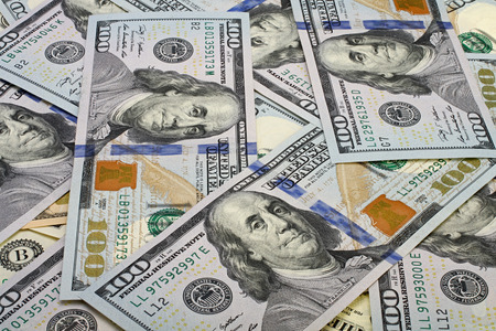 Foto de A pile of one hundred dollar bills as background. - Imagen libre de derechos