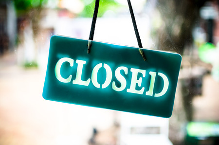 Photo for Close sign hanging on glass of shop. - Royalty Free Image