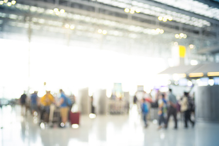 Blur background of Terminal Departure Check-in at airport with bokeh.