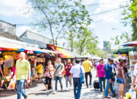 Foto de Blurred background  people shopping at market fair in sunny day, blur background with bokeh. - Imagen libre de derechos