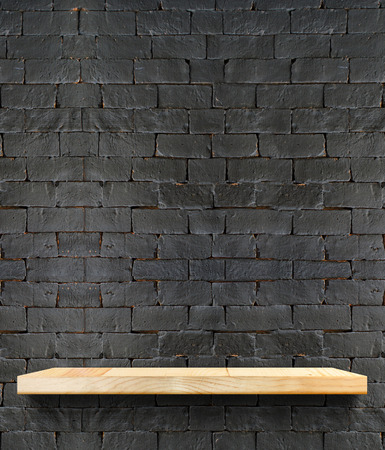 Photo for Empty Wooden shelf at black brick wall,Template mock up for display of product,business presentation. - Royalty Free Image