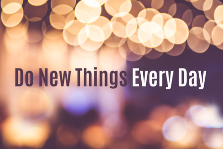 Foto de Inspiration quote :  Do new things every day with blur bokeh background ,Motivational typographic. - Imagen libre de derechos
