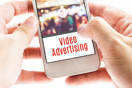 Photo pour Close up Two hand holding mobile with Video Advertising word, Digital business concept. - image libre de droit