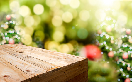 Foto de Empty wood plank food stand with blur Christmas tree bokeh light background,Template mock up for display or montage of product. - Imagen libre de derechos