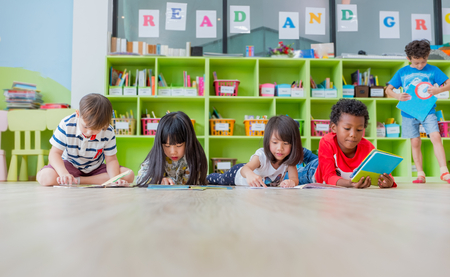 Photo for Group of diversity kid lay down on floor and reading tale book in preschool library,Kindergarten school education concept. - Royalty Free Image