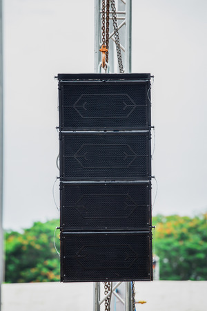 Photo for Set of powerful speakers hanging over the stage. Daylight shot - Royalty Free Image
