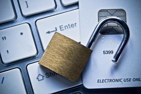 Foto de open security lock on credit cards with computer keyboard / credit card data theft concept - Imagen libre de derechos