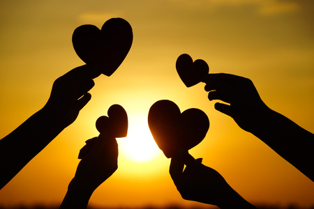 Foto per hands holding hearts silhouette - Immagine Royalty Free