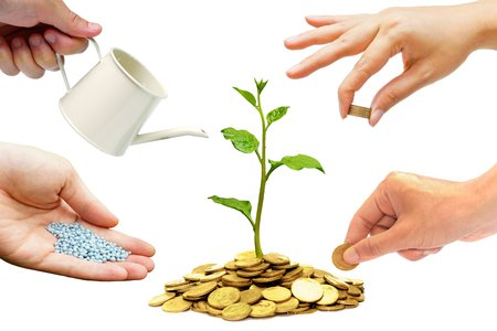 Photo for Hands helping planting trees growing on coins together - Building business with csr and ethics - Royalty Free Image