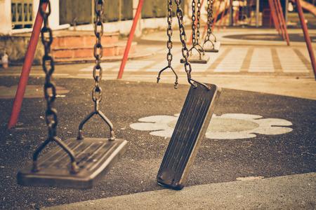 Foto de Broken chain swing in playground - Imagen libre de derechos