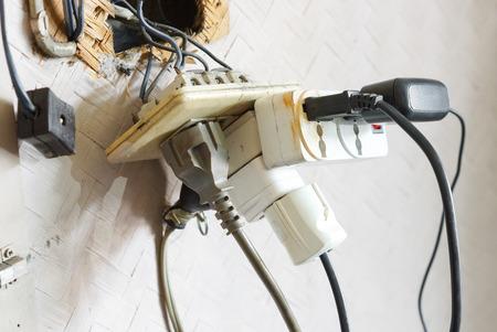 Foto de Too many plugs in a socket / Danger of using too much electricity - Imagen libre de derechos