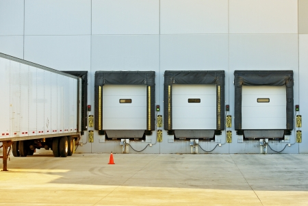 Photo for Semi Truck Trailer Warehouse Loading / Unloading. Large Modern American Warehouse Building. Shipping and Cargo Photo Collection. - Royalty Free Image