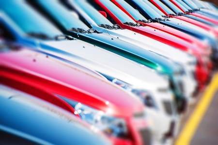 Foto de Colorful Cars Stock. Cars For Sale. Dealer Lot Cars Row. - Imagen libre de derechos