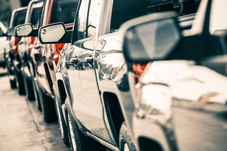 Foto de Cars Traffic Closeup. Urban Transportation Concept. Pickup Trucks Line. - Imagen libre de derechos