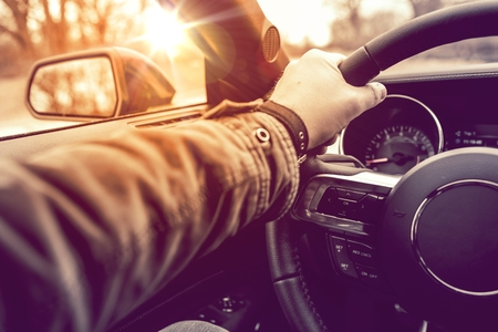 Photo pour Hand on Wheel Car Driving.  Driving Modern Car Steering Wheel and the Hand Closeup. - image libre de droit