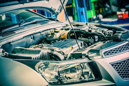 Photo pour Car Repairing. Modern Compact Car with Open Hood. Car Under Maintenance. - image libre de droit