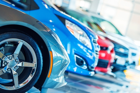 Foto per Brand New Cars For Sale in Dealer Showroom. Car Business. - Immagine Royalty Free