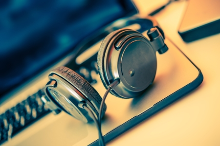 Photo for Headphones on Laptop Computer - Royalty Free Image