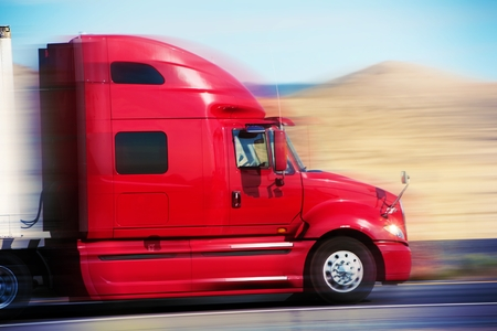 Photo for Red Semi Truck on the Road - Royalty Free Image