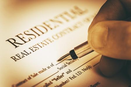 Photo pour Signing Residential Real Estate Contract Closeup Photo - image libre de droit
