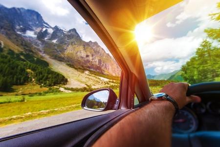 Photo pour Mountains Summer Road Trip. Driving Along the Alps Mountains. - image libre de droit