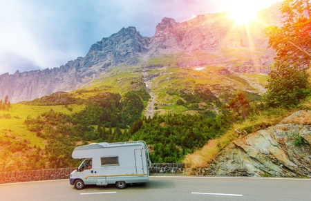Photo for Camper Mountain Trip. Class C Camper Van on a Summer Mountain Road. Camper Journey. - Royalty Free Image
