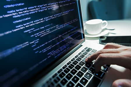 Foto de Programming Work Time. Programmer Typing New Lines of HTML Code. Laptop and Hand Closeup. Working Time. Web Design Business Concept. - Imagen libre de derechos